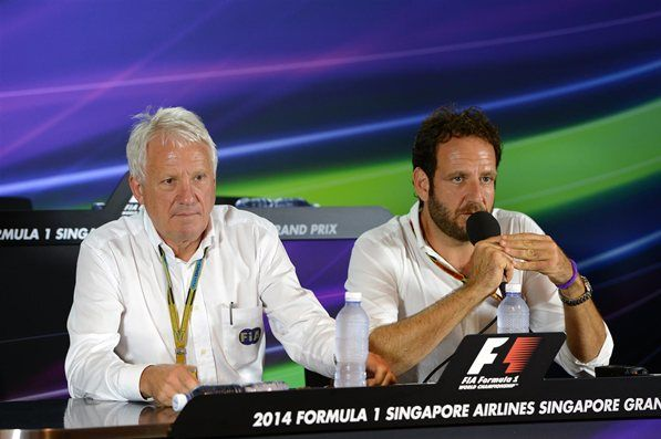 (L to R): Charlie Whiting (GBR) FIA Delegate and Matteo Bonciani (ITA) FIA Media Delegate in a Press Conference. Formula One World Championship, Rd14, Singapore Grand Prix, Marina Bay Street Circuit, Singapore, Practice, Friday, 19 September 2014
