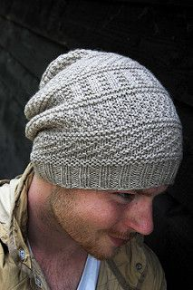 This textured hat gives the perfect amount of slouch for cozy casual look. The knit-purl patterning beautifully highlights a solid worsted weight yarn. An optional button can be added to tack down the slouchy fabric.