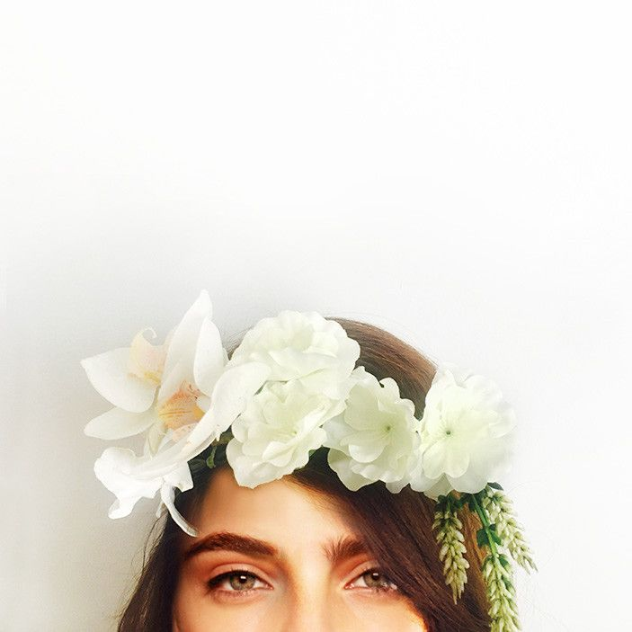 This crown is handcrafted with cymbidium orchid, dendrobium orchid and blossoms.    Perfect for your engagement, bridal shower or hen's night; you can wear it confidently knowing it won't wilt or fall apart throughout the day. We love that you can wear it again after your special event or keep it as a treasured memento.