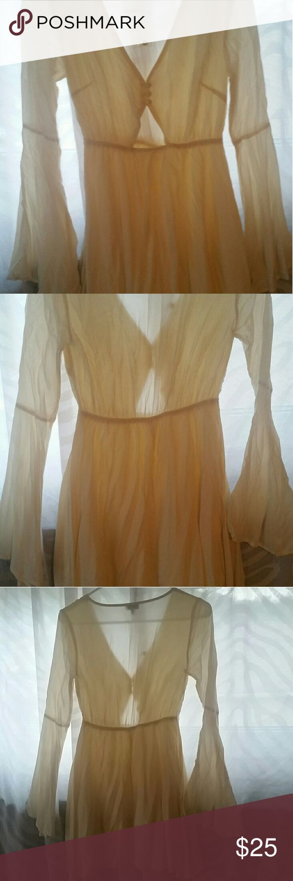 Bell sleeve mini dress Semi sheer ivory,cream color dress, never worn,purchased from Tobi. Has bell sleeves and a fit and flare style to it, just too small for my chest area. Tobi Dresses Mini