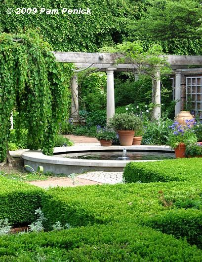 Beautiful english gardens pond with a fountain anchored for English garden pool