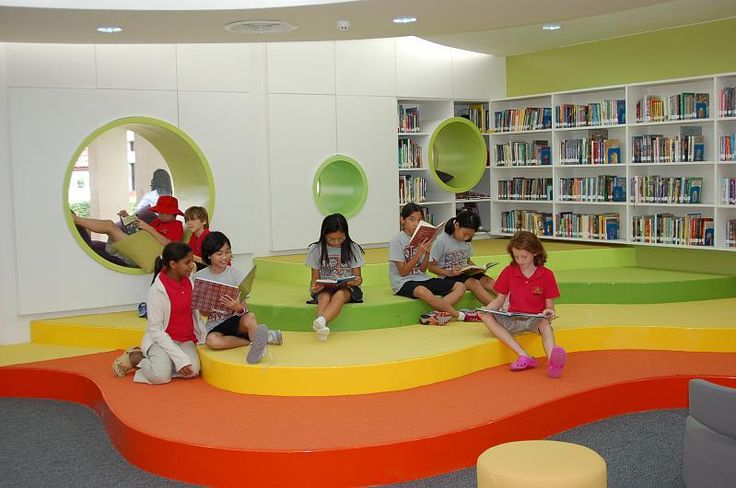 Stadium seating and group reading area that can be used by students as well. Love the colors and fun nooks!