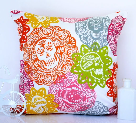 Now I'm in trouble.  These pillow prints rock! http://www.etsy.com/listing/90651299/skull-cushion-skull-pillow-colorful