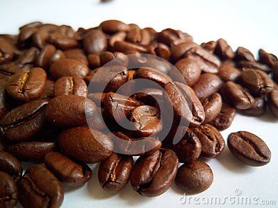A shot of roasted coffee beans on a white background