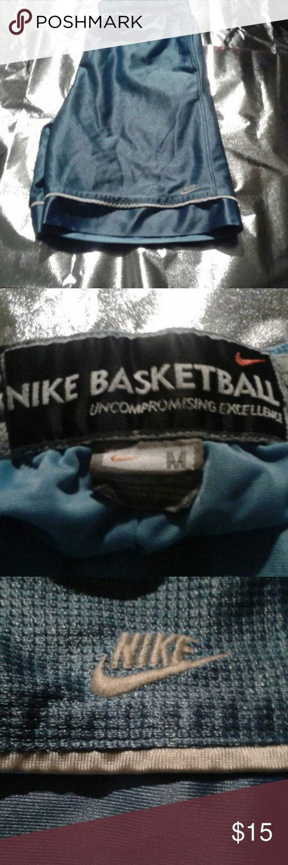 Nike basketball shorts Blue M (8-10) I'm guessing because of the size they are women's.  Too big to be kids. Nike Shorts