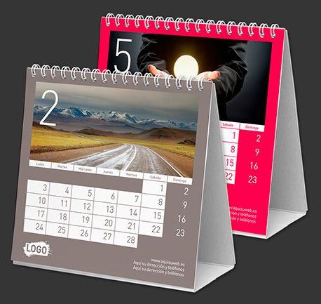 Calendarios de mesa personalizados Colour Line 15x14 cm  Características:  - Impreso a todo color  - 14 páginas (7 hojas a 2 caras)  - Papel estucado brillo 200 g.  - Encuadernación wire-o (similar espiral)  - Peana cartón super-grueso  - Tu logo en todas las páginas  - 1 foto a elegir en cada página  - Idiomas a elegir  - Calendario lunar  $1.85