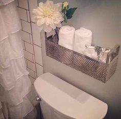 I'm iffy about towels and open jars of cotton balls and swabs above a toilet because of splash; however, I like the organization.