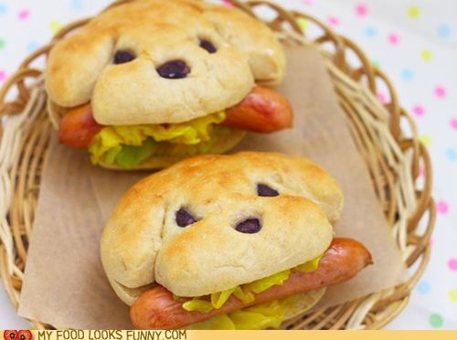 Hot Dog Hot Dogs How does one improve on the great hot dog? Well you really can't, but you can make the bun a little more fun. The nose and eyes are made with black beans, but maybe we could swap those out for raisins?