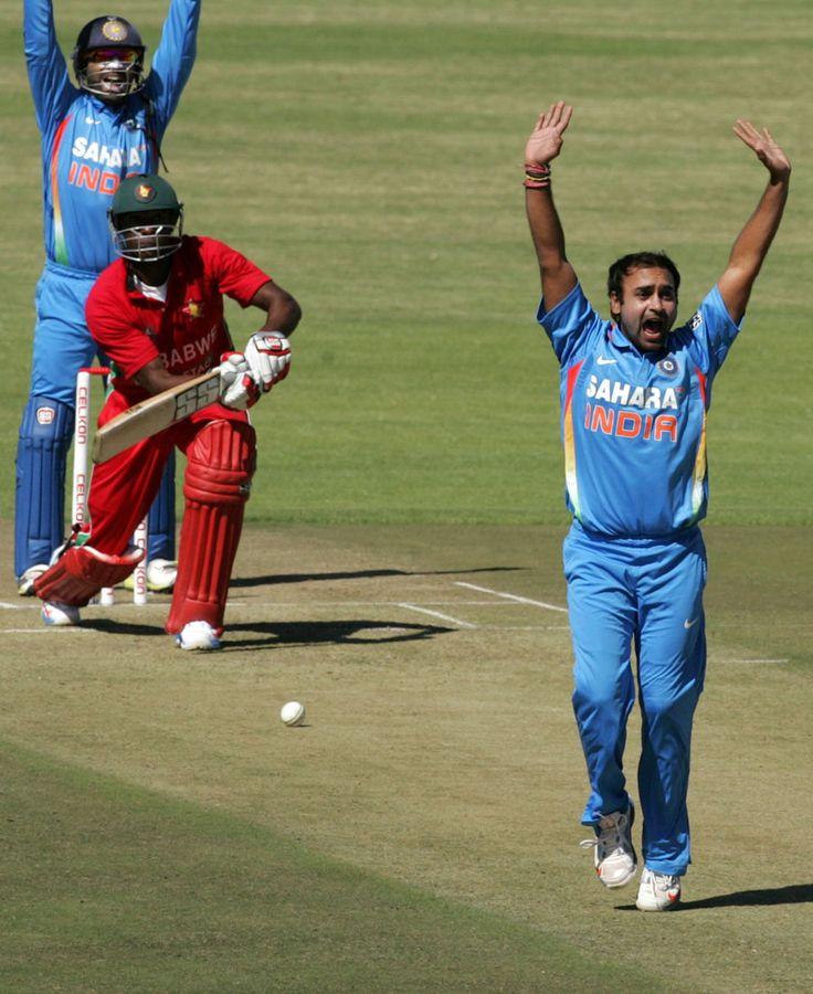 Amit Mishra and Dinesh Karthik appeal for the wicket of Vusi Sibanda, Zimbabwe v India, 1st ODI, Harare, July 24, 2013