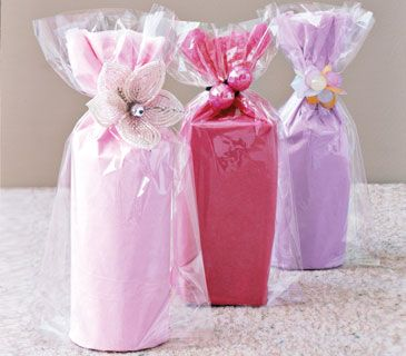Secure a gift with an embellished ponytail holder a lucky little girl can use when the party is over.