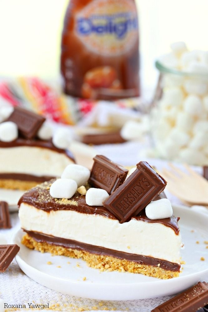 This easy to make No Bake S'mores Cheesecake features layers of decadent buttery crust, rich chocolate ganache, airy marshmallow cheesecake filling and a second layer of chocolate ganache. Check out the simple, step by step recipe! One bite and you're in love!