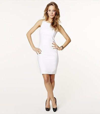 Embrace the white trend this spring with this chic white pencil dress! Pair it with a statement necklace.
