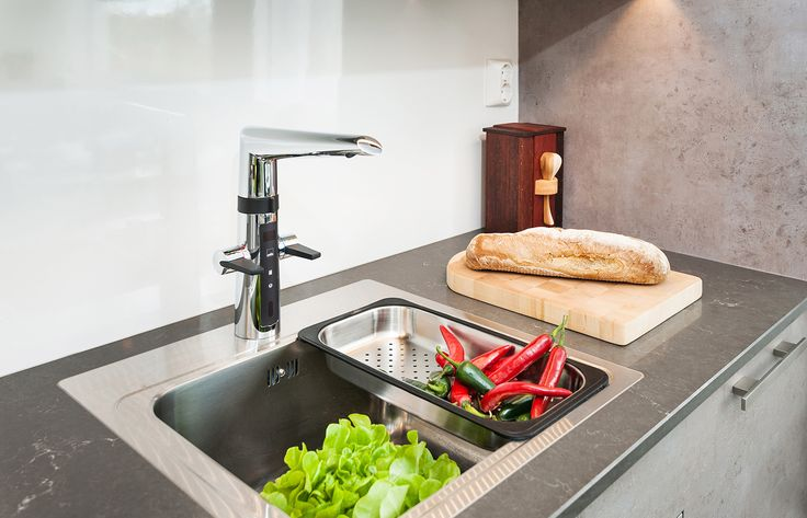 Oras Optima - smart kitchen faucet with a dishwasher valve and hybrid function.