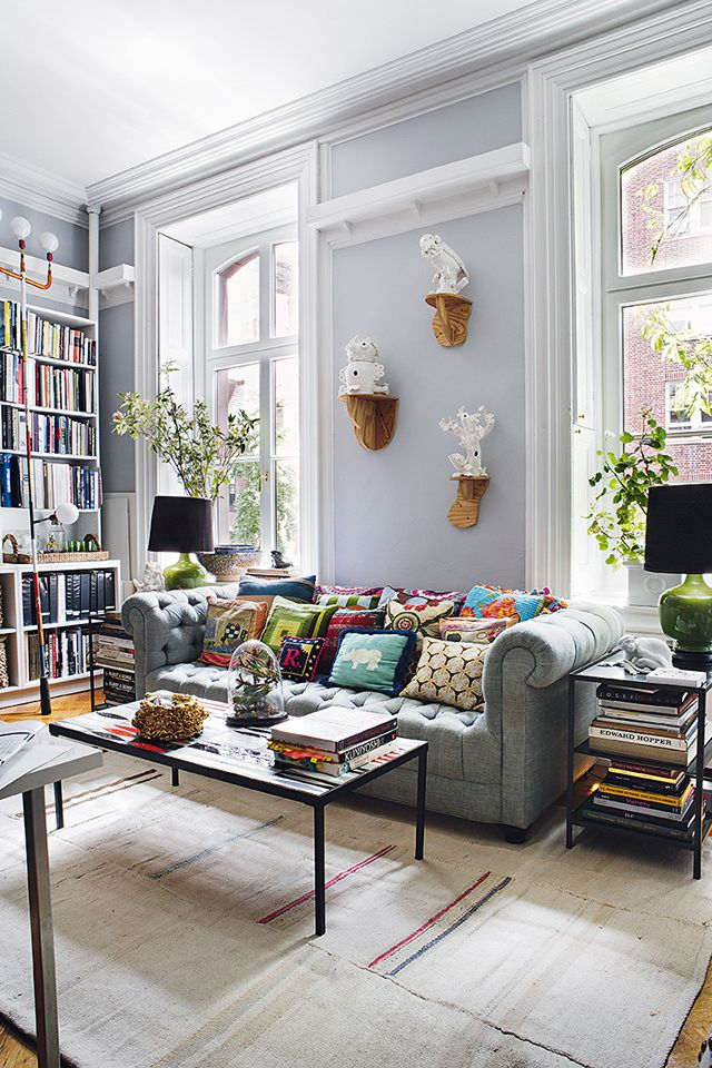 I love how every bit of eclectic flair comes together so delightfully in interior designer Rodman Primack's West Village apartment. Each component in his one bedroom apartment is either chic, witty or worldly. A patchwork quilt, a Rick Owens bench, fabrics from his own textile line, a
