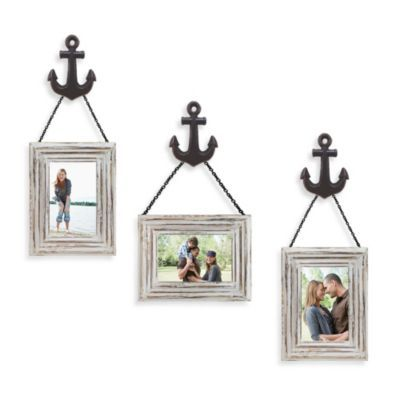Nautical themed picture frame hangers ... Wall Solution 6-Piece Anchor Frame Set in White - BedBathandBeyond.com