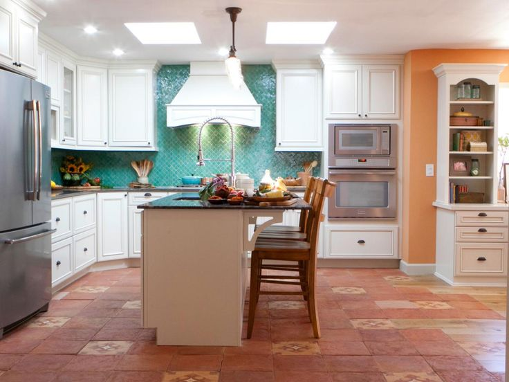 In order to add a stove, cabinets and appliances in the kitchen, the french doors had to be removed and a wall need to be added. Because valuable light was being taken away, the Kitchen Cousins added two skylights into the ceiling.