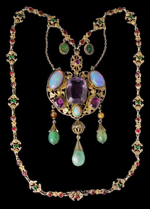 AUSTRO HUNGARIAN Necklace  Gilded silver Amethyst Opal Emerald Agate Paste Pendant: H: 10 cm (3.94 in)  W: 4.8 cm (1.89 in)  Necklace: L: 50 cm (19.69 in)  Marks: Dogs head & WM Austro-Hungarian, c.1900