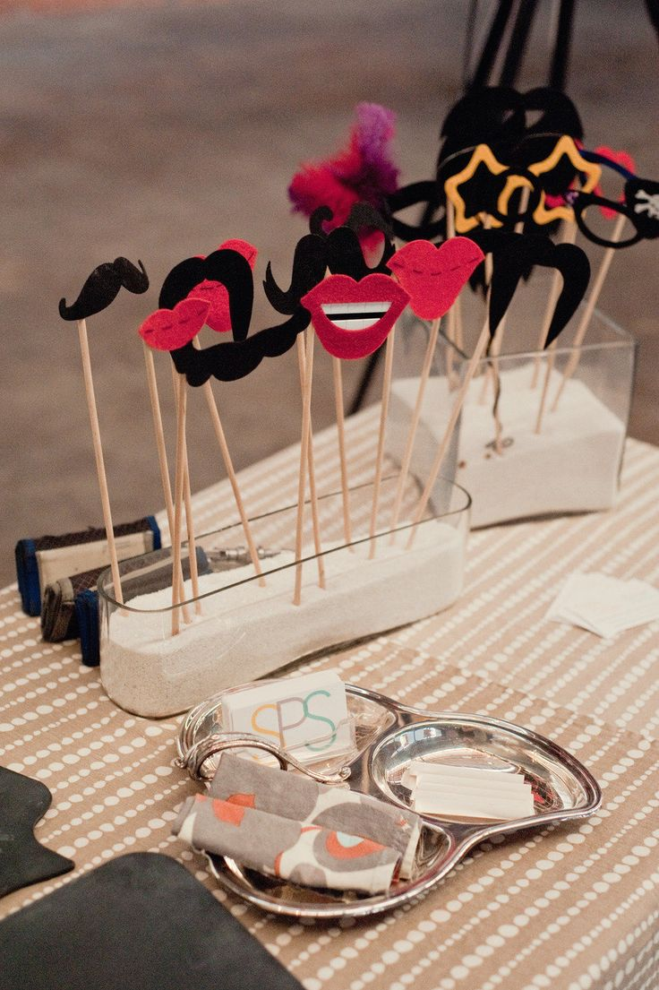 Props on a stick! Love how they are displayed! Sand in a fun glass jar! Great for wedding favours
