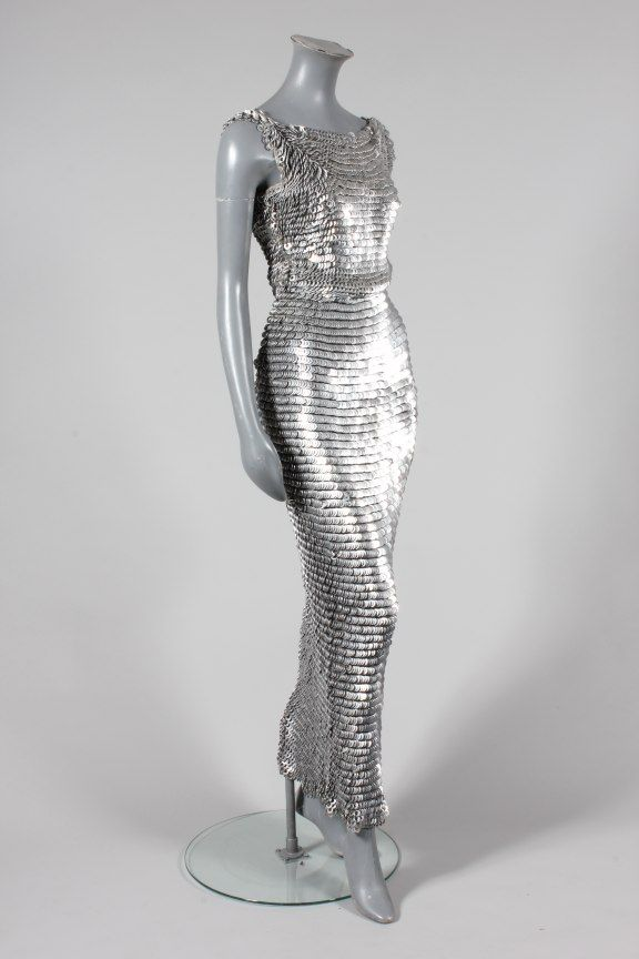 A Paco Rabanne chain-mail sheath, 1970s, the knitted cotton mesh ground inter-looped with silver metal discs giving an over-lapping fish-scale effect, with a demi-lune panel to the front bodice, figure hugging skirt with fish-tail hem