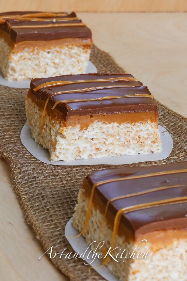 Chocolate Caramel Rice Krispie Squares. Chocolate covered rice krispie squares with a gooey caramel layer.