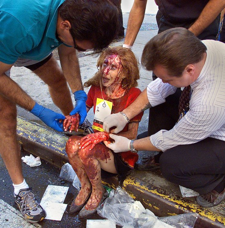 *9/11 ~ A WOMAN SAT IN SHOCK ON THE CURB ON CHURCH STREET IN FRONT OF TRINITY CHURCH: The Towers' Rise and Fall - Photographs - NYTimes.com