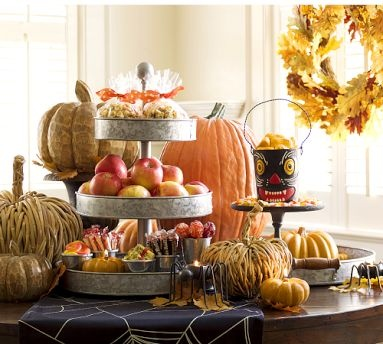 photo from Pottery Barn. I really like that 3 tiered thing in the middle with the goards and apples etc.