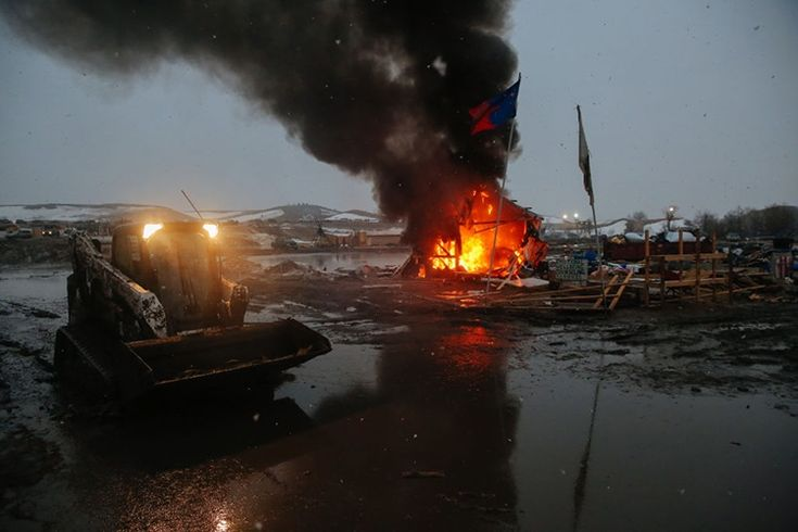 22 February 2017: American government closed down the camp at Standing Rock. Protesters burnt their dwellings in a last symbollic act:  (Image taken from: )  Article about protest in th…