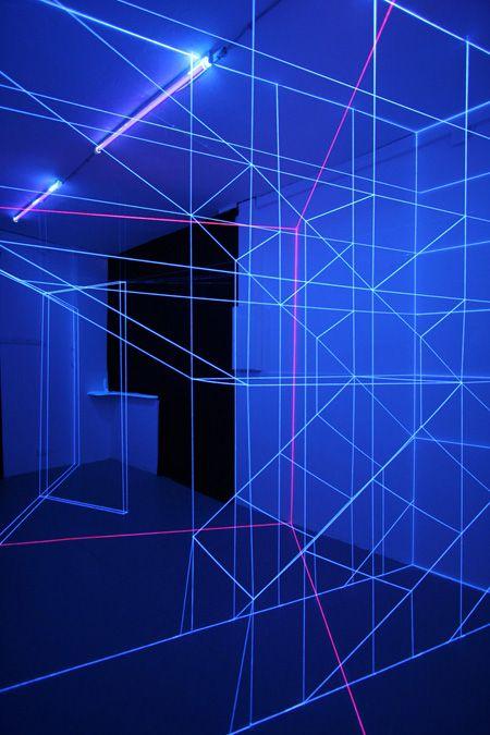 "Jeongmoon Choi, ""Construction"" / 2011 / approx. 30 sqm space, threads, black lights Exhibition ""AMARCORD"" / Gallery Fellini, Berlin"