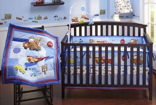 """The Disney Baby Cars Junior Junction 4-Piece Crib Bedding Set features Lightning McQueen and Mater, two of the movie's most lovable characters. Perfect for your little boy's nursery, this set will add a splash of fun to any look. Disney Baby - Cars Junior Junction 4-Piece Crib Bedding Set:  ?Includes: ?Appliqued comforter with plush border, 42"""" x 33"""" ?4-section Secure-Me bumper ?Dust ruffle, 9"""" drop ?Crib sheet, 28"""" x 52"""" ?Fabric: 65 percent poly..."""