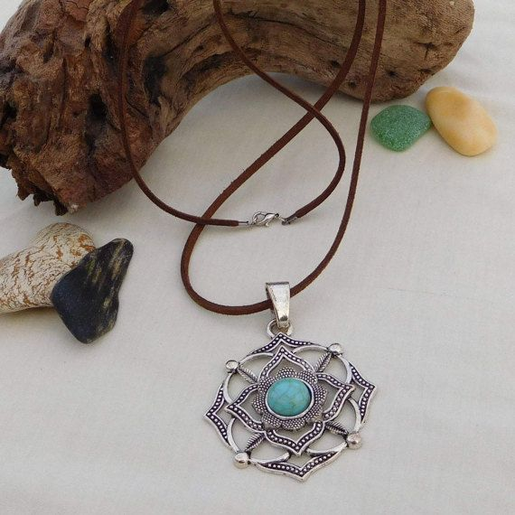 One of my favorite pieces is this amazing flower shaped metallic mandala pendant, with a nice turquoise ceramic bead in the center and a soft suede chord. Be the first to have it and complete your outfit with this beautiful boho style pendant Total length 36.00 cm  You can choose from a black or brown suede chord Chord length can be adjustable, according to your will, just let me know before you make your order
