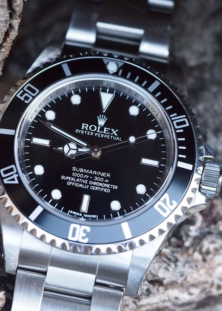 Rolex Submariner Ref 14060M. In 2010 Baselworld Rolex replaced this with the current maxi dialed, maxi cased ceramic bezel version the Ref 114060.