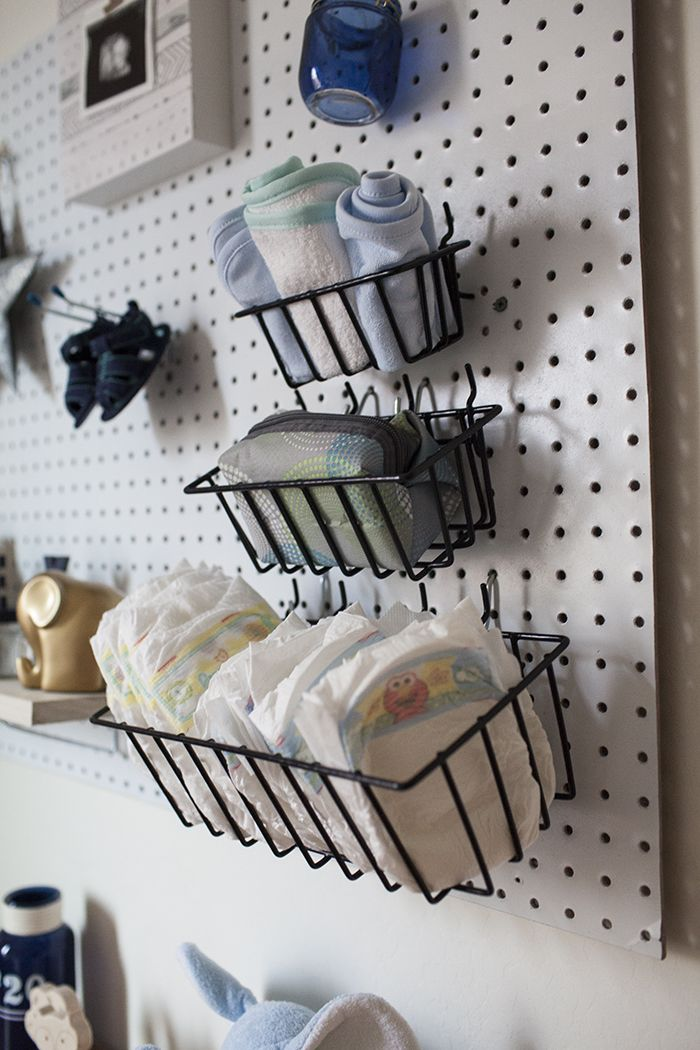 Looking for a way to organize and decorate your nursery at the same time? This nursery peg board project is the perfect way to do that and it's so easy!