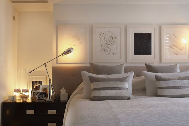 Kelly Hoppen/.….I like the pictures lined up behind bed, I like the lamp, I like the pillows, but using only one band across middle,  using a softer fabric, not shiny….c