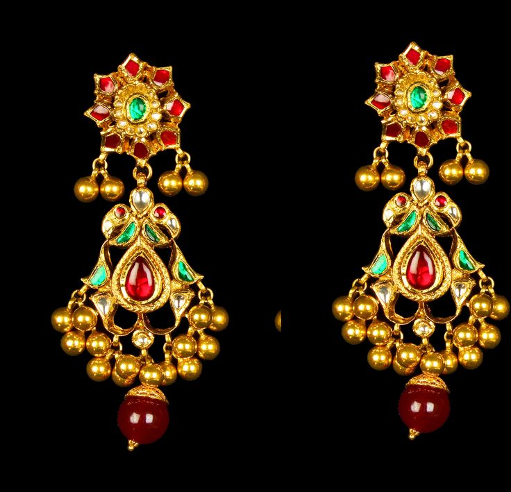 Antique Earring. Reminiscent of the trellis work screens of the Mughals, these gold earrings echo the beauty of filigree work in gold. The fluidity is enhanced with green and red Tourmalines, the sparkle of Kundan and the earrings are edged with delicate bunches of tinkling gold beads. A single teardrop Tourmaline ruby bead adds the perfect regal character and finishing touch to these elegant, antique finish ear drops