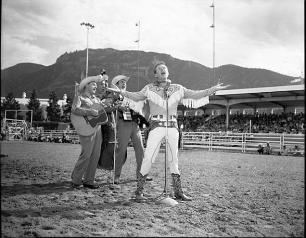 REX ALLEN - MR. COWBOY - Western film & recording star Rex Allen performs with the Frontiersmen - Pikes Peak or Bust Rodeo - Colorado Springs, CO - 1958.