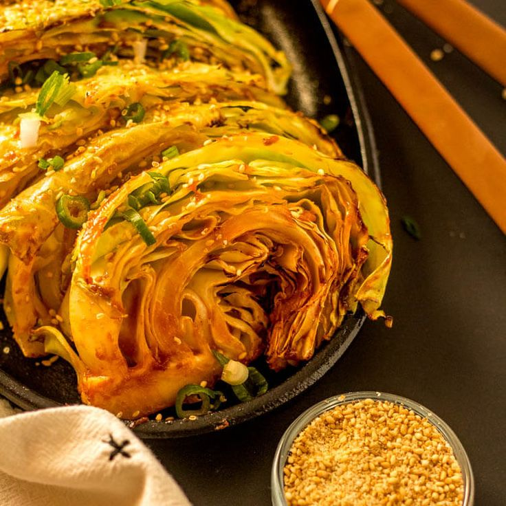 "An addictive spicy sauce that gets its ""kick"" from gochujang dresses up Grilled Cabbage Wedges with a Korean Glaze... This grilled cabbage is anything but bland, and super easy to make! Serve with your favorite Asian main dish and shake things up a bit! Healthy, gluten free, low carb, and delicious!"