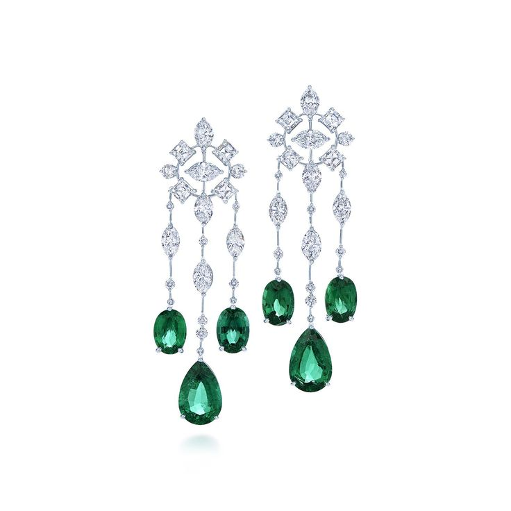 Diamond and emerald chandelier earrings in platinum.