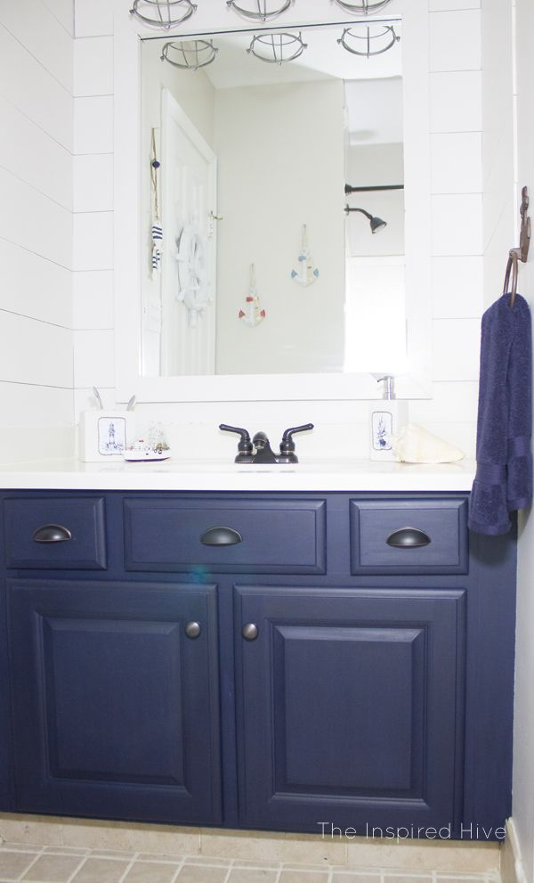 Update your bathroom vanity with chalk paint. Check out this nautical bathroom makeover.