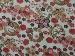 Photograph of Japanese style red green gold chrysantimum motifs on white fabric at Lee Nova Craft