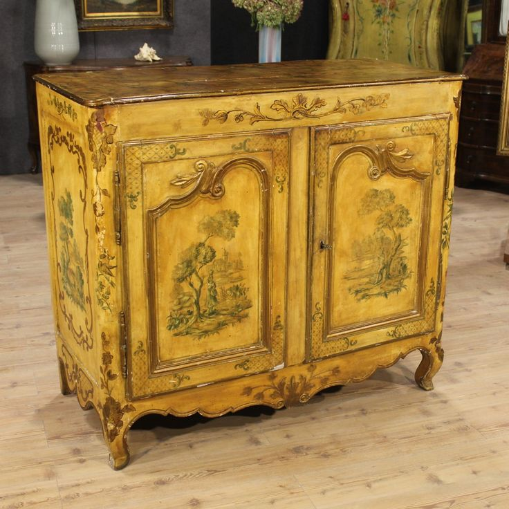 Price: 2600€ French sideboard of the eighteenth century. Provençal furniture in carved, lacquered and hand-painted wood. Lacquering and painting of the early twentieth century. Wooden upper floor painted faux marble. Cupboard with two doors and missing internal shelves. Furniture with a functioning key, the lock is not original replaced during the twentieth century. Overall in fair conditions with some signs of the time. #antiques #antiquariato Visit our website www.parino.it