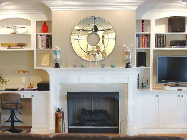 Ok HGTV - this one comes in a close second .....Fireplace Mantel Designs....Yeah, those stuffed bunnies and sheep look great stuffed into the hurricane lamps......was somebody getting high before they shot this?  Come on, really !!!!!