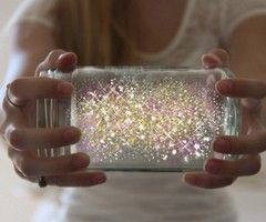 This is just so fun and awesome. And what a fun activity for those summer nights? Especially if you don't have lightning bugs. Cut open a glow stick and pour it into a jar.  Add diamond  glitter, then shake with the lid on!