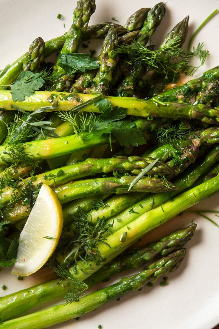 For the first-of-the-season asparagus, keep it simple with butter, lemon and sweet herbs. For the best texture, peeling the stalks really makes a difference. (Photo: Evan Sung for The New York Times)