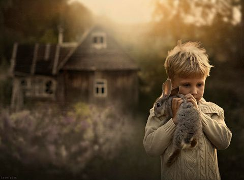 Russian photographer's dreamy pictures of her two boys and their animals