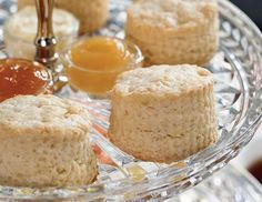 Simple but traditional Cream Scones, served with clotted cream, lemon curd, and jam, are the best part of afternoon tea.