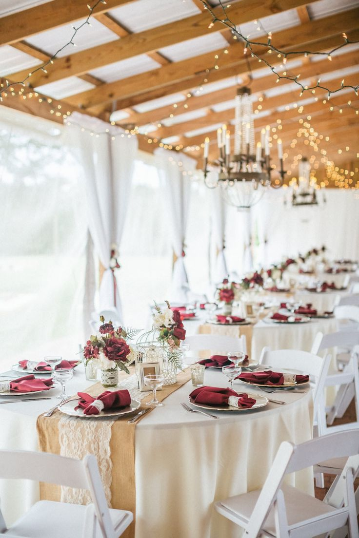 Rustic Barn Wedding Reception With String Lights Chandeliers Burlap And Lace Runners On Cream