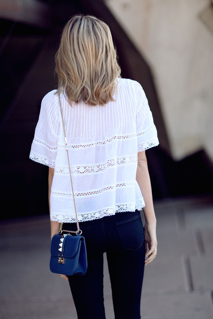 Flowy white blouse and shoulder bag