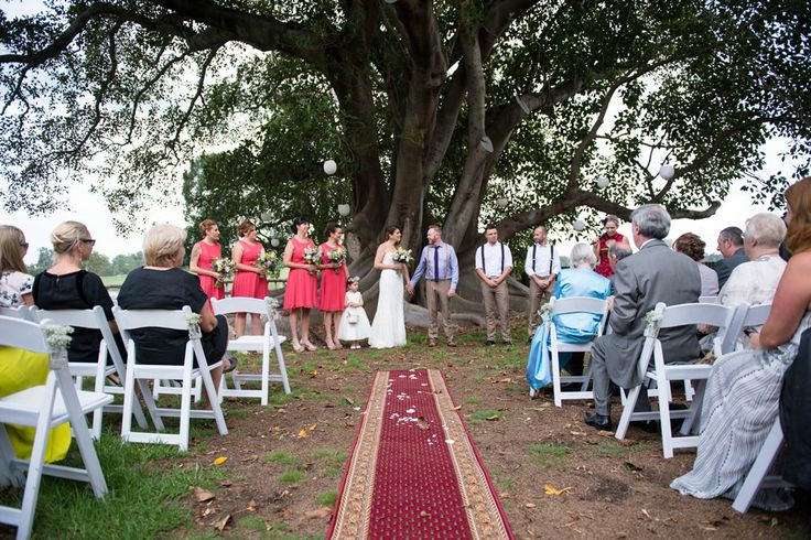 Outdoor wedding ceremony in front of the beautiful fig trees!