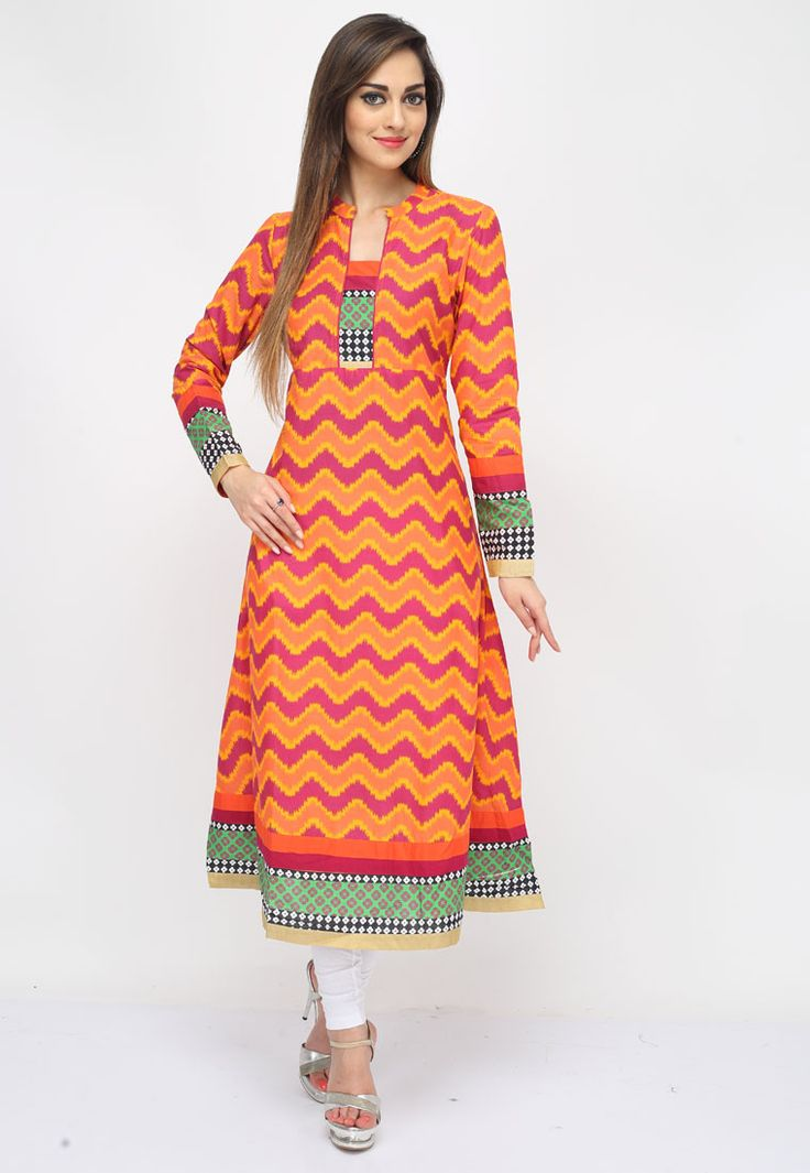 Add oodles of charm into your #dailywear by adding this Orange-Pink Color Cotton #DesignerKurti showcasing trendy zigzag prints along with distictive yoke, cuffs and border embellished with lace work