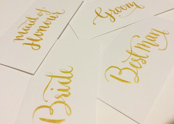Gold Wedding Place Card Calligraphy by BlueCalligraphy on Etsy https://www.etsy.com/uk/listing/241576666/gold-wedding-place-card-calligraphy